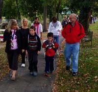 Parents and students walk to school together