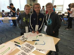 Students use Ozobots